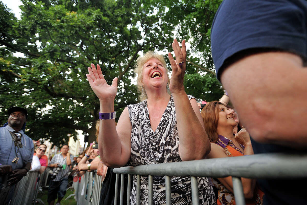 Sharon Ballin cheers on KC and the Sunshine Band during Alive@5 in Columbus Park in Stamford, Conn., on Thursday, July 10, 2014. Hearst Connecticut Media Group is a sponsor of the event.