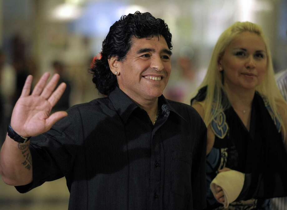 (FILE) Argentine football legend Diego Maradona and girlfriend Veronica Ojeda arrive for the opening of a mall in Canning, on the outskirts of Buenos Aires, on December 18, 2008. Ojeda told Argentine website Ciudad.com on September 21, 2012 that the former star and current Honorary Ambassador of Sports in Dubai will have a new son, for she is four months pregnant. Maradona has two daughters from his marriage to Claudia Villafaé±e, Dalma and Giannina, and a son named Diego from an extramarital relationship with Italian Claudia Singara.   AFP PHOTO/JUAN MABROMATAJUAN MABROMATA/AFP/GettyImages Photo: JUAN MABROMATA, Staff / AFP ImageForum