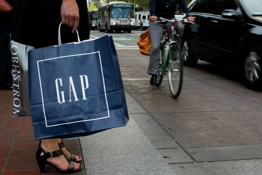 A shopper waits to cross Market Street in San Francisco, the home city of Gap. Photo: David Paul Morris / © 2014 Bloomberg Finance LP