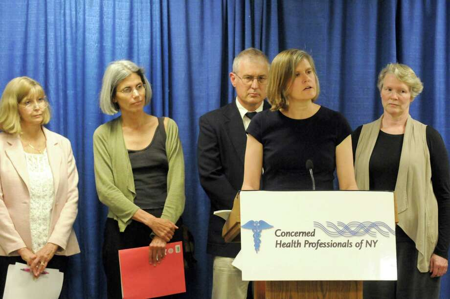 Sandra Steingraber, PhD, Distinguished Scholar in Residence at Ithaca College, at podium, with Concerned Health Professionals of New York speaks on fracking health issues during a Concerned Health Professionals of New York press conference Thursday, July 10, 2014, at the Legislative Office Building in Albany, N.Y. (Michael P. Farrell/Times Union) Photo: Michael P. Farrell / 00027739A