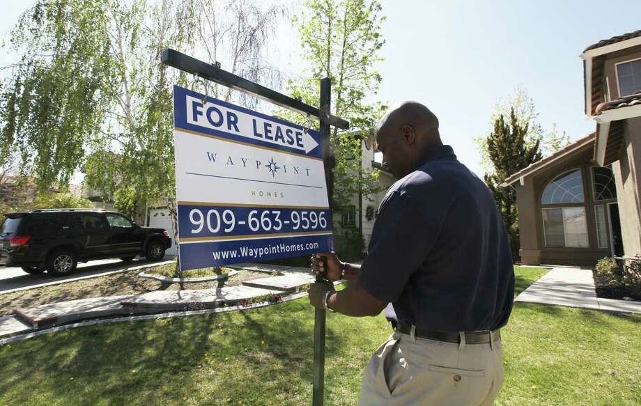 A for-lease sign is posted in San Bernardino, Calif, by an inspector for Waypoint Real Estate Group, which is considering selling about half of its 4,000 homes. Photo: Monica Almeida / New York Times / NYTNS