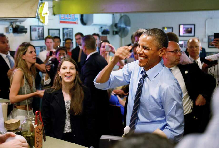 President Barack Obama visits Franklin Barbecue in Austin with Kinsey Button, left, a UT student from Houston who wrote the president about her family's job struggles. Photo: Kye R. Lee, POOL / Pool The Dallas Morning News