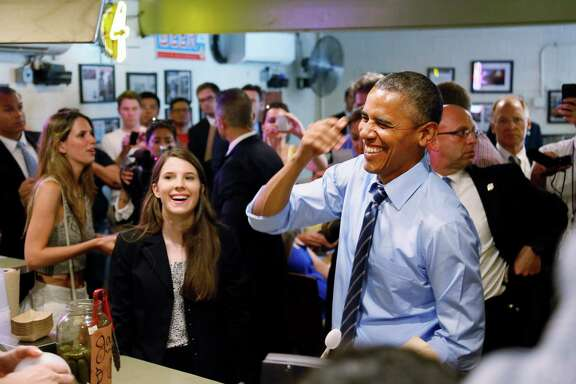 President Barack Obama visits Franklin Barbecue in Austin with Kinsey Button, left, a UT student from Houston who wrote the president about her family's job struggles.