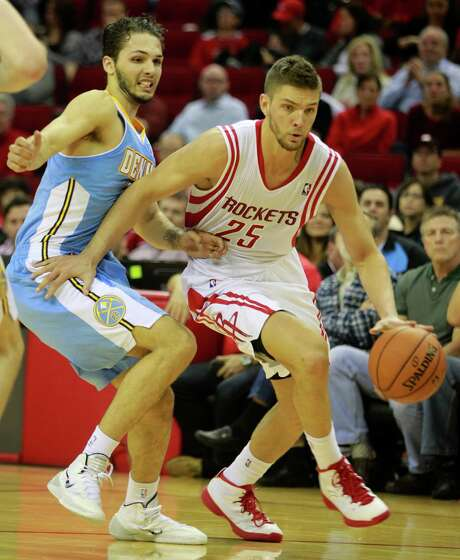 Houston Rockets Chandler Parsons drives around Denver Nuggets Evan Fournier during the second half of NBA game at Toyota Center Sunday, April 6, 2014, in Houston. ( Melissa Phillip / Houston Chronicle ) Photo: Melissa Phillip, Staff / © 2014  Houston Chronicle