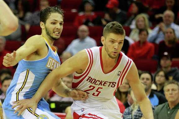 Houston Rockets Chandler Parsons drives around Denver Nuggets Evan Fournier during the second half of NBA game at Toyota Center Sunday, April 6, 2014, in Houston. ( Melissa Phillip / Houston Chronicle )