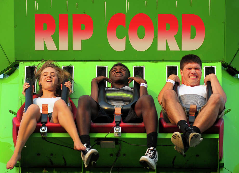 Riders on the Rip Cord ride react as they freefall, during the Monroe Fire Deparment Carnival at Fireman's Field in Monroe, Conn. on Thursday July 10, 2014. The carnival, located at the intersections of Route 110 and 111, continues through Saturday July 12th. Photo: Christian Abraham / Connecticut Post