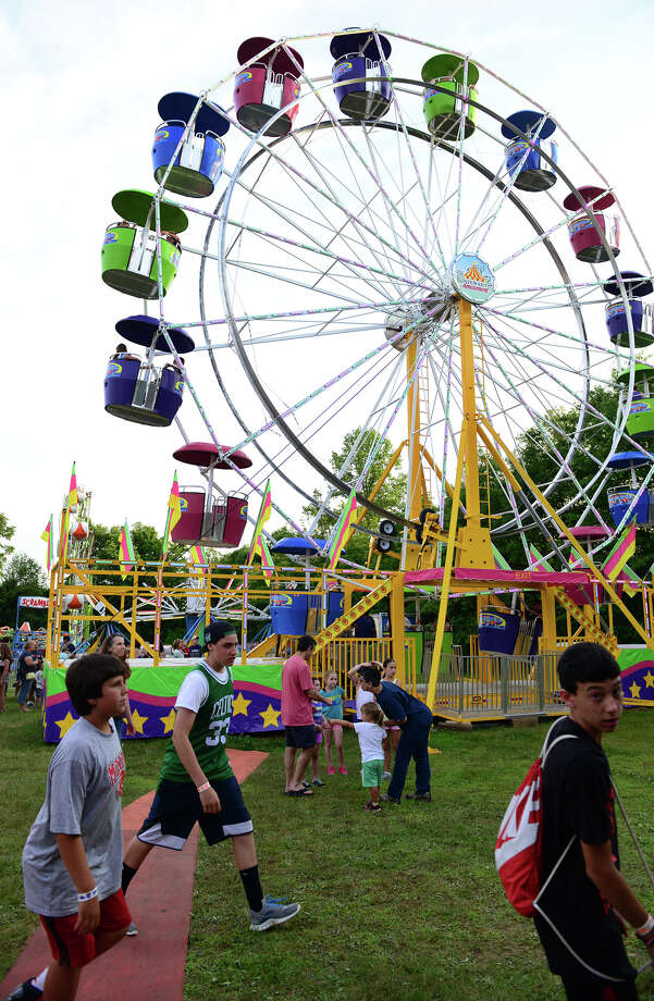 The Monroe Fire Deparment Carnival at Fireman's Field in Monroe, Conn. on Thursday July 10, 2014. The carnival, located at the intersections of Route 110 and 111, continues through Saturday July 12th. Photo: Christian Abraham / Connecticut Post