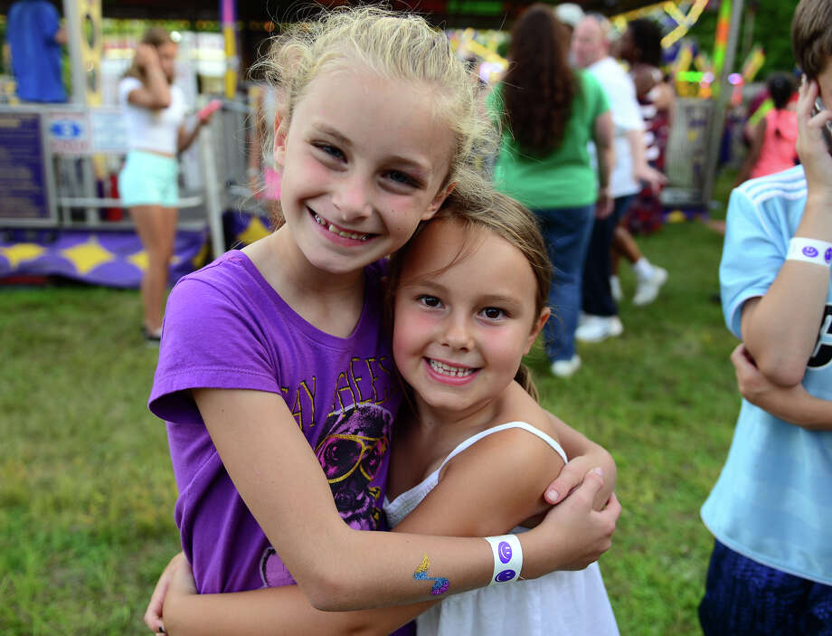 Eliza Brakeman, 6, of Monroe, left, and her cousin Phoebe Brakeman, 6, of Fairfield, enjoy the Monroe Fire Deparment Carnival at Fireman's Field in Monroe, Conn. on Thursday July 10, 2014. The carnival, located at the intersections of Route 110 and 111, continues through Saturday July 12th. Photo: Christian Abraham / Connecticut Post