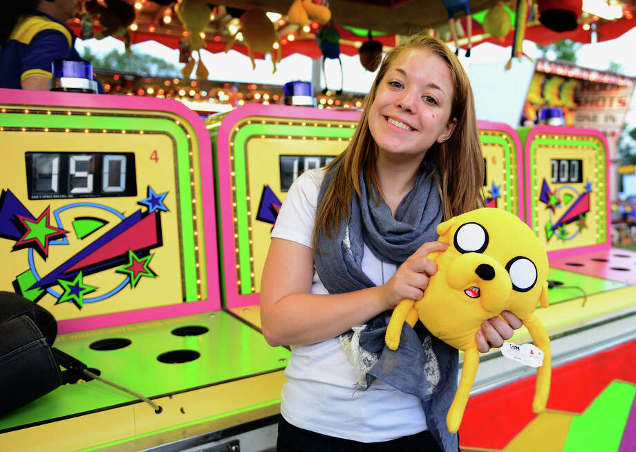 Hannah Schwartz, of Monroe, shows off her prize after playing Whack-A-Mole, during the Monroe Fire Deparment Carnival at Fireman's Field in Monroe, Conn. on Thursday July 10, 2014. The carnival, located at the intersections of Route 110 and 111, continues through Saturday July 12th. Photo: Christian Abraham / Connecticut Post