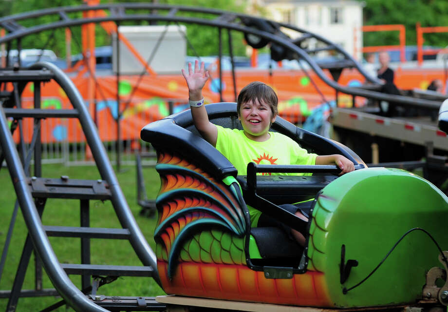 Jonah Schwartz, 9, of Monroe, enjoys the Monroe Fire Deparment Carnival at Fireman's Field in Monroe, Conn. on Thursday July 10, 2014. The carnival, located at the intersections of Route 110 and 111, continues through Saturday July 12th. Photo: Christian Abraham / Connecticut Post