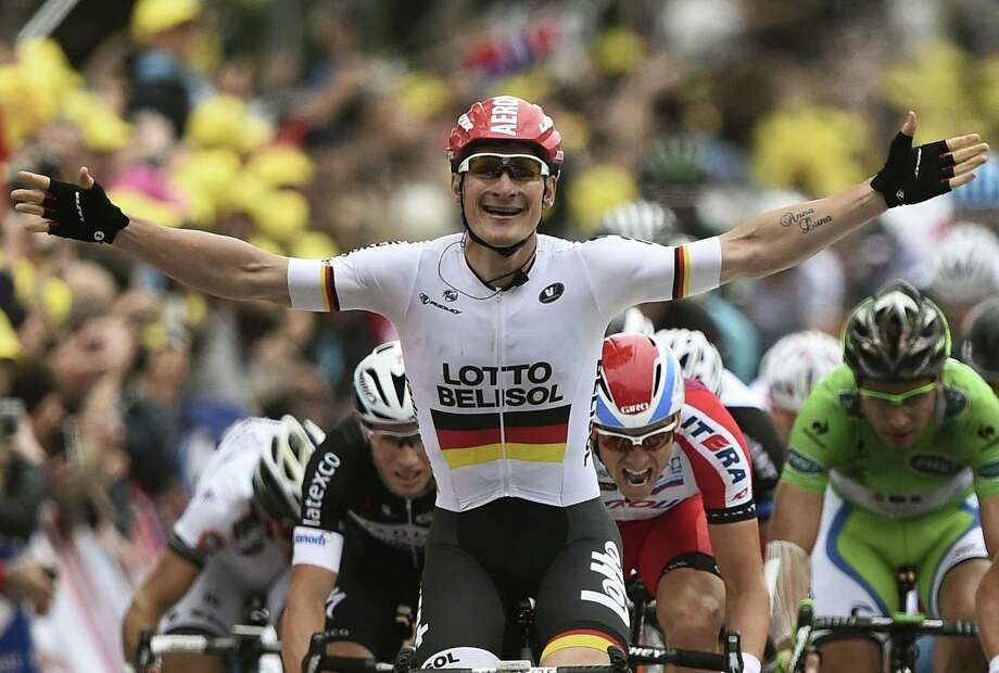 Andre Greipel of Germany exults as he crosses the finish line in front during the Tour de France's sixth stage, a 120-mile ride from Arras to Reims, France. Vincenzo Nibali of Italy kept the overall lead, two seconds ahead of Denmark's Jakob Fuglsang. Photo: Lionel Bonaventure / AFP / Getty Images / AFP