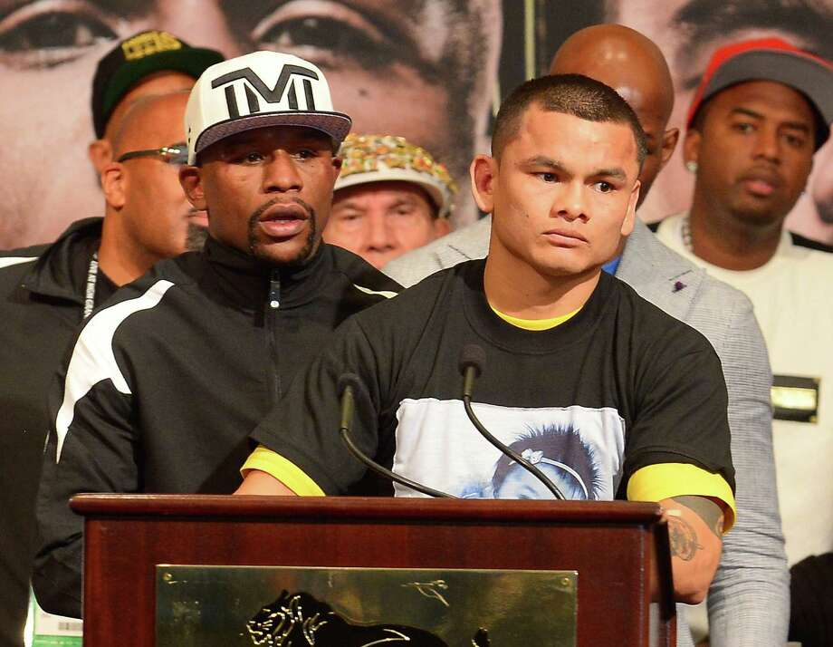 Floyd Mayweather Jr. (left) and Marcos Maidana will make a stop at Fiesta Texas on Tuesday. They are set to fight Sept. 13. Photo: Bryan Steffy / WireImage / 2014 WireImage