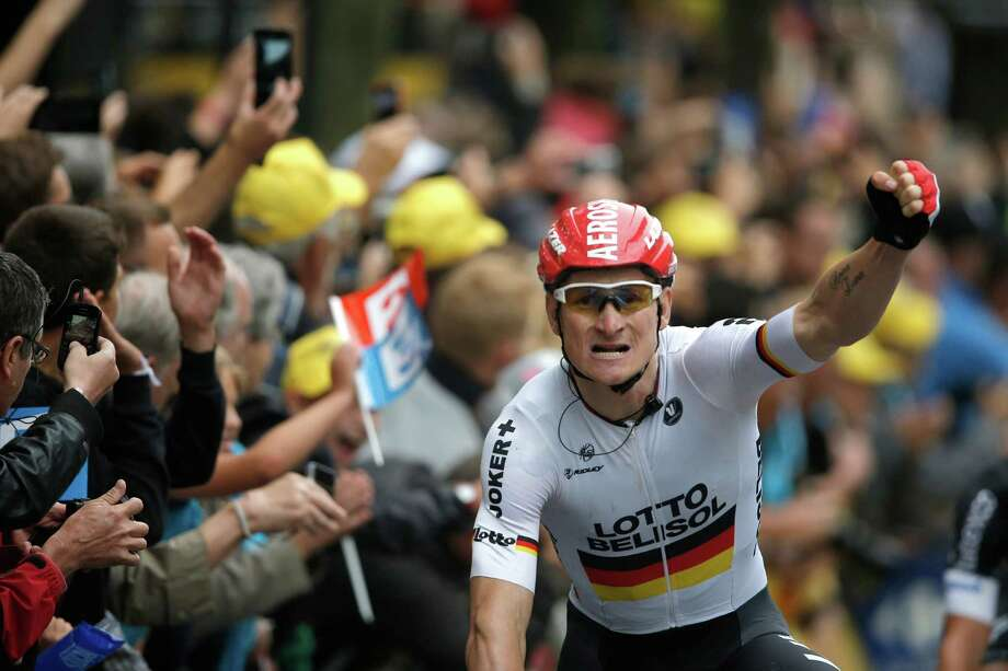 Germany's Andre Greipel crosses the finish line to win the sixth stage of the Tour de France on Thursday. Photo: Peter Dejong, STF / AP