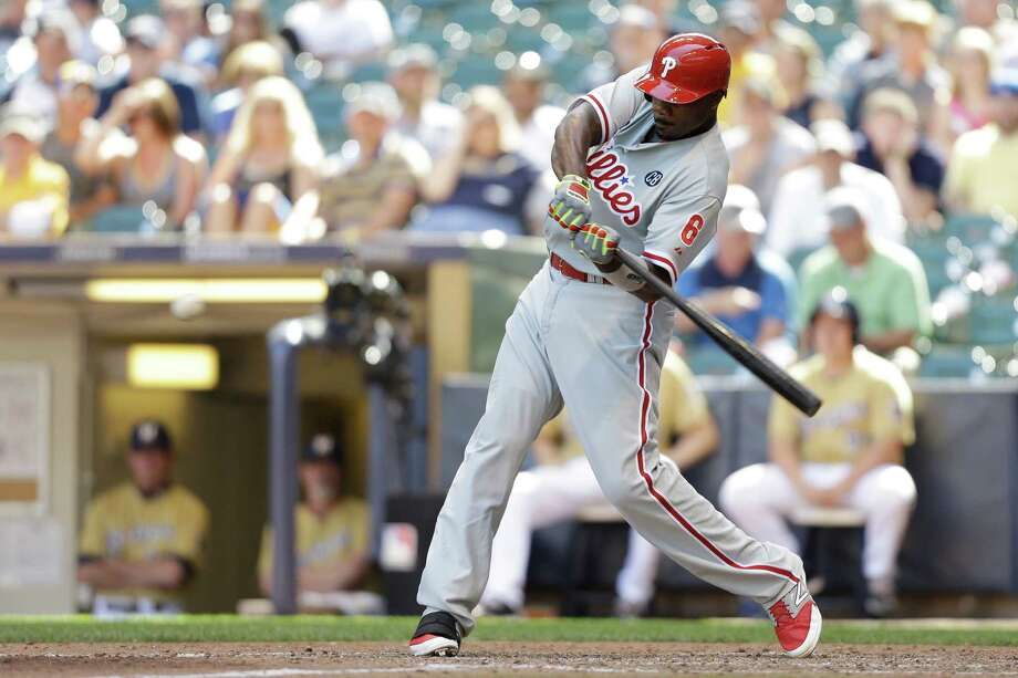 MILWAUKEE, WI - JULY 10: Ryan Howard #6 of the Philadelphia Phillies hits a two-run home run in the top of the ninth inning against the Milwaukee Brewers at Miller Park on July 10, 2014 in Milwaukee, Wisconsin. (Photo by Mike McGinnis/Getty Images) ORG XMIT: 477586261 Photo: Mike McGinnis / 2014 Getty Images