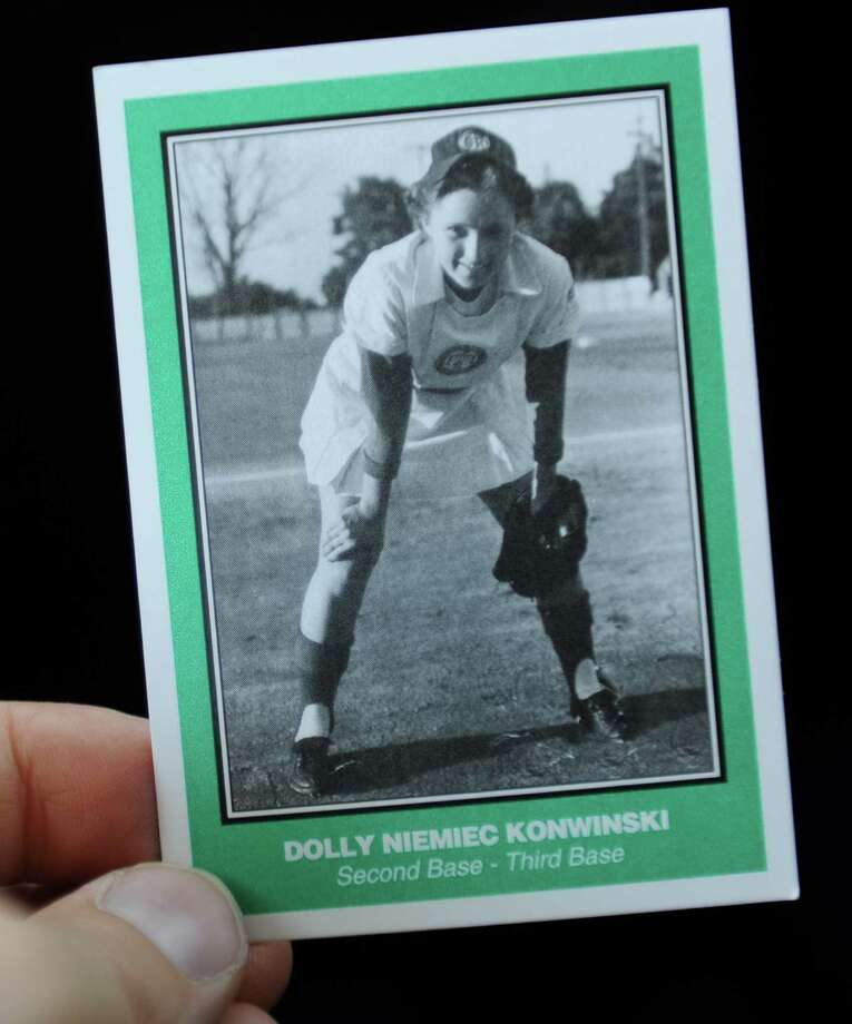 "Dolly Konwinski who was an AAGPBL player during the 1947 - 1952 seasons is seen in a baseball card at the Guilderland Library where she spoke Thursday, July 10, 2014 in Guilderland, N.Y. A popular movie ""A League of Their Own"" was made about the league. (Lori Van Buren / Times Union) Photo: Lori Van Buren / 00027740A"