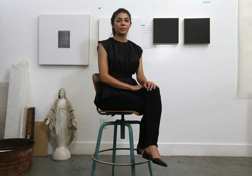 Artist Adriana Corral poses in her studio on the first level of a renovated fire station, Thursday, July 3, 2014.