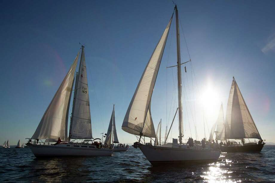 Dozens of sailboats take to the water as part of the Downtown Sailing Series hosted by Elliott Bay Marina on Thursday, June 10, 2014. Participants in the race have 90 minutes to sail along a course that starts at Elliott Bay Marina and runs along the downtown Seattle waterfront. The rules of the race are simple: Don't hit anyone. Those that complete the race within 90 minutes are entered to win a drawing for prizes. DSS is in its eleventh year and runs until Aug. 14, 2014. Those without a boat can still participate by registering online at www.seattleboatshow.com. Photo: JOSHUA BESSEX, SEATTLEPI.COM / SEATTLEPI.COM