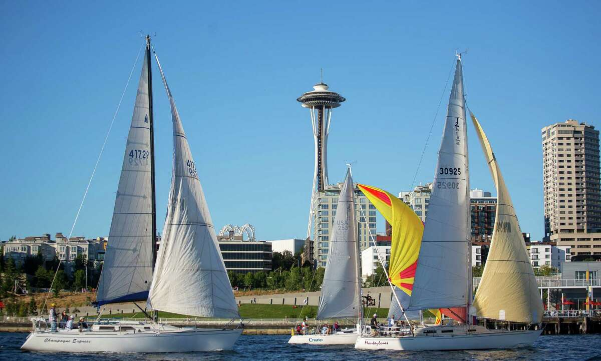 Sailboats pass by the Space Needle during the race. Dozens of sailboats took to the water as part of the Downtown Sailing Series hosted by Elliott Bay Marina on Thursday, June 10, 2014. Participants in the race have 90 minutes to sail along a course that starts at Elliott Bay Marina and runs along the downtown Seattle waterfront. The rules of the race are simple: Don't hit anyone. Those that complete the race within 90 minutes are entered to win a drawing for prizes.