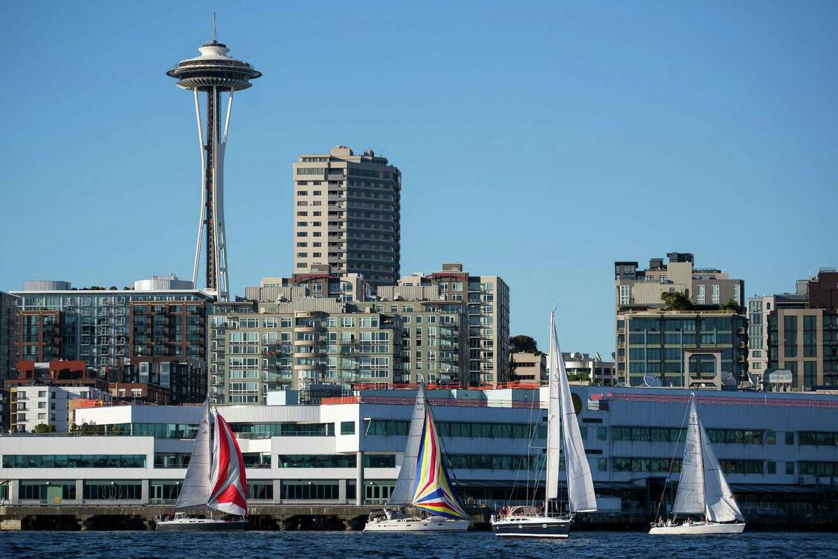 Dozens of sailboats take to the water as part of the Downtown Sailing Series hosted by Elliott Bay Marina on Thursday, June 10, 2014. Participants in the race have 90 minutes to sail along a course that starts at Elliott Bay Marina and runs along the downtown Seattle waterfront. The rules of the race are simple: Don't hit anyone. Those that complete the race within 90 minutes are entered to win a drawing for prizes.