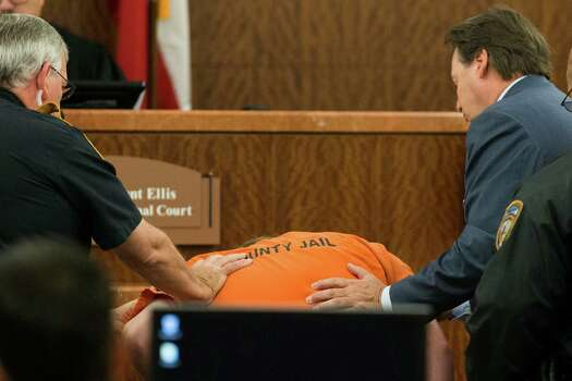 Accused mass shooter Ron Lee Haskell collapses as he appears in court on Friday, July 11, 2014, in Houston. Haskell is accused of a mass shooting that resulted in the death of six people. Photo: Brett Coomer, Houston Chronicle / © 2014 Houston Chronicle