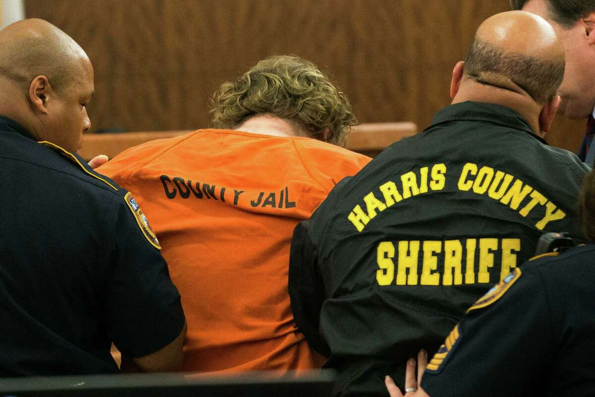 Accused mass shooter Ron Lee Haskell collapses as he appears in court on Friday, July 11, 2014, in Houston. Haskell is accused of a mass shooting that resulted in the death of six people.
