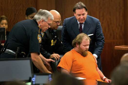 Accused mass shooter Ron Lee Haskell is wheeled from the courtroom after collapsing during a hearing on Friday, July 11, 2014, in Houston. Haskell is accused of a mass shooting that resulted in the death of six people. Photo: Brett Coomer, Houston Chronicle / © 2014 Houston Chronicle