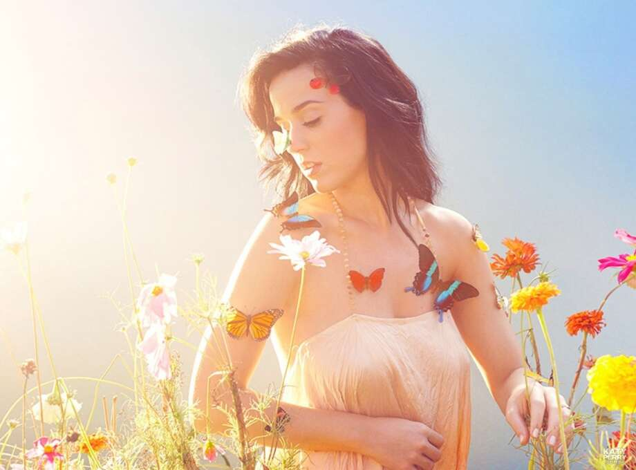 At the mid-way point of 2014, Katy Perry is among the best selling album artists. Click through to see who else made the Top 20. Photo: Capitol Records