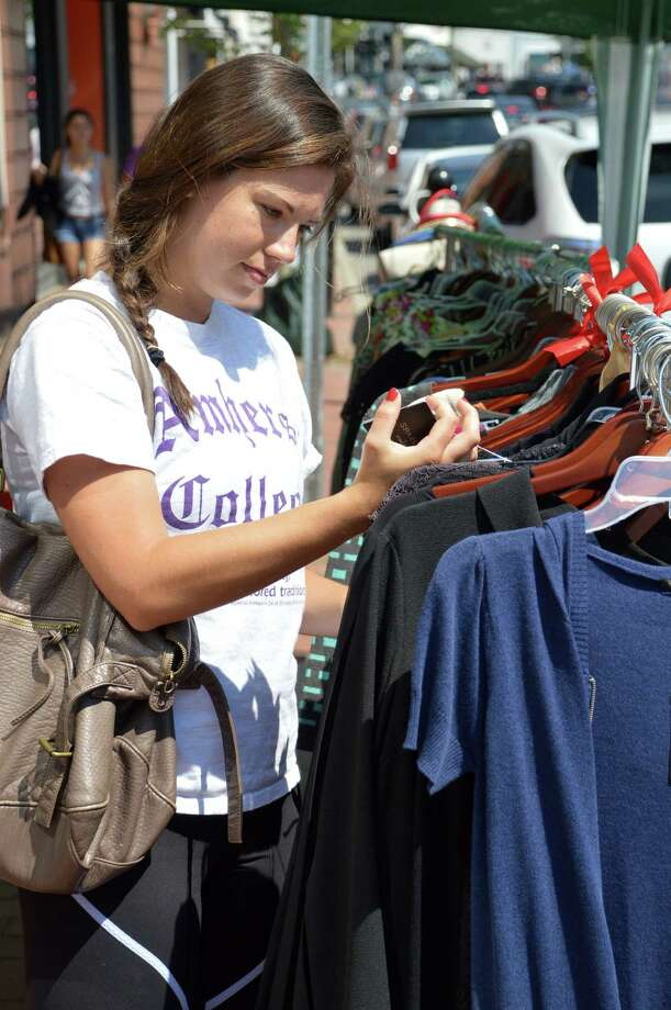 Saskia Pounan-Gray of Weston was among the shopping crowds drawn downtown by the Westport Sidewalk Sales. Photo: Jarret Liotta / Westport News