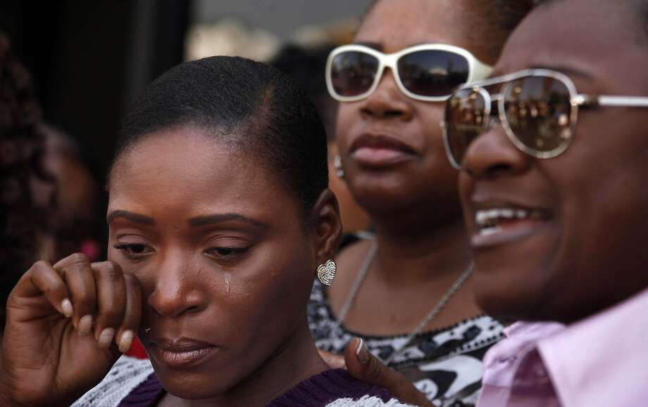 Maisha Allums (left) tears up as attorney Caree Harper (right) describes how her mother, Marlene Pinnock, was repeatedly punched this month by a California Highway Patrol officer. Photo: Genaro Molina, Los Angeles Times