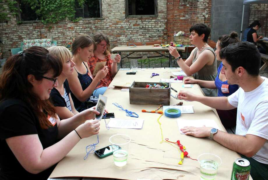 Group at Etsy works on crafts on Friday June 6, 2014 at the Esty Headquarters in Hudson N.Y. (Selby Smith / Special to the Times Union) Photo: Selby Smith / 00027175A