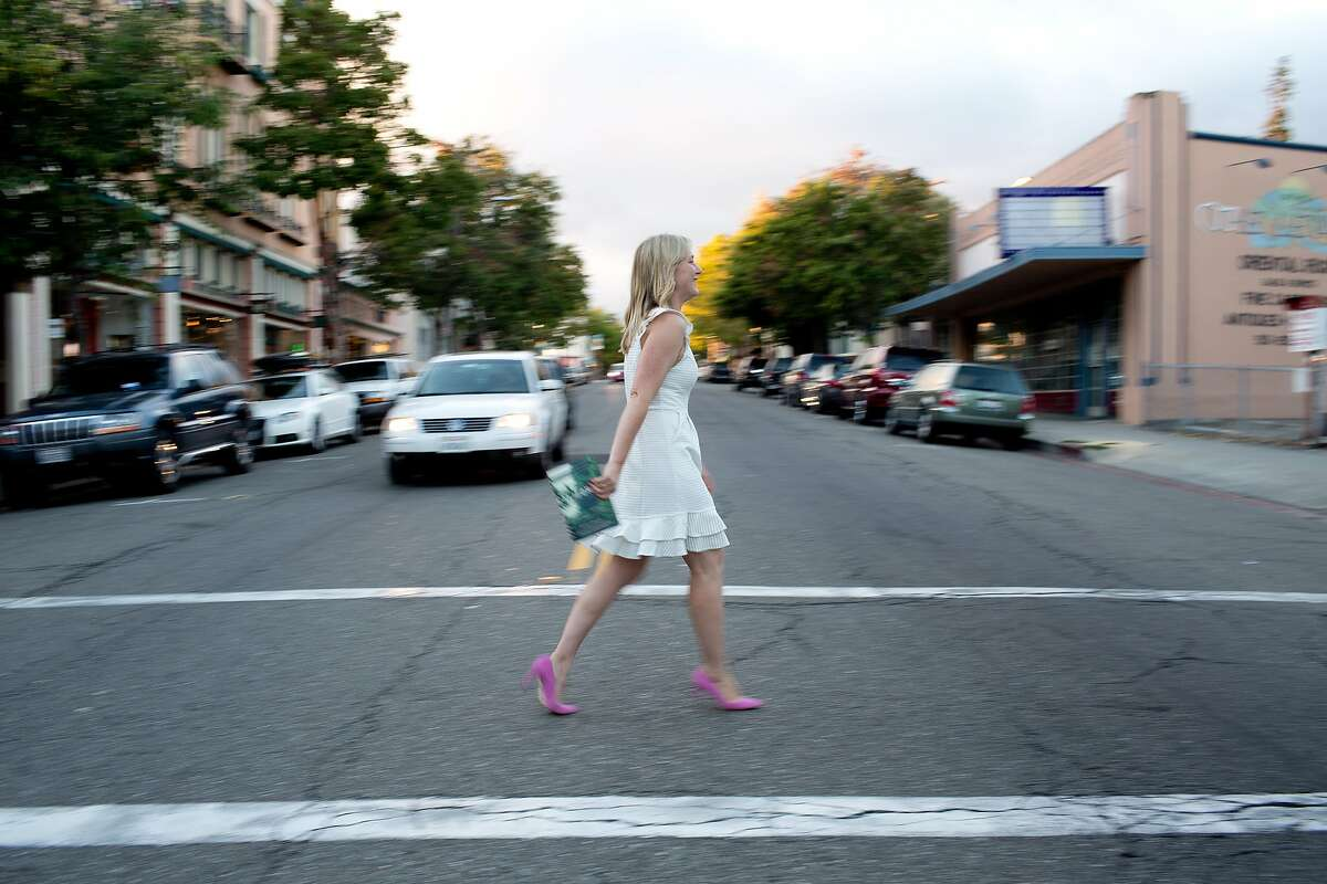 Author Edan Lepucki walks across College Ave. for the photographer with her new book, California, after a reading at Diesel, A Bookstore in Oakland, Calif. on Thursday, July 10, 2014. After a dispute between Amazon and Hachette Book Group, her publisher, Amazon removed the pre-order button for all Hachette books, including hers. Stephen Colbert, who is also a Hachette author, told his viewers to buy her book from Powell's Books, of Portland, Oregon. After this comment, sales of her book have skyrocketed.