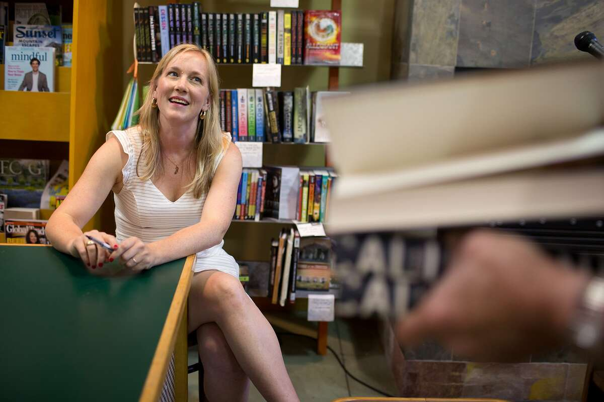 Author Edan Lepucki holds a book signing after reading from her new book, California, at Diesel, A Bookstore in Oakland, Calif. on Thursday, July 10, 2014. After a dispute between Amazon and Hachette Book Group, her publisher, Amazon removed the pre-order button for all Hachette books, including hers. Stephen Colbert, who is also a Hachette author, told his viewers to buy her book from Powell's Books, of Portland, Oregon. After this comment, sales of her book have skyrocketed.