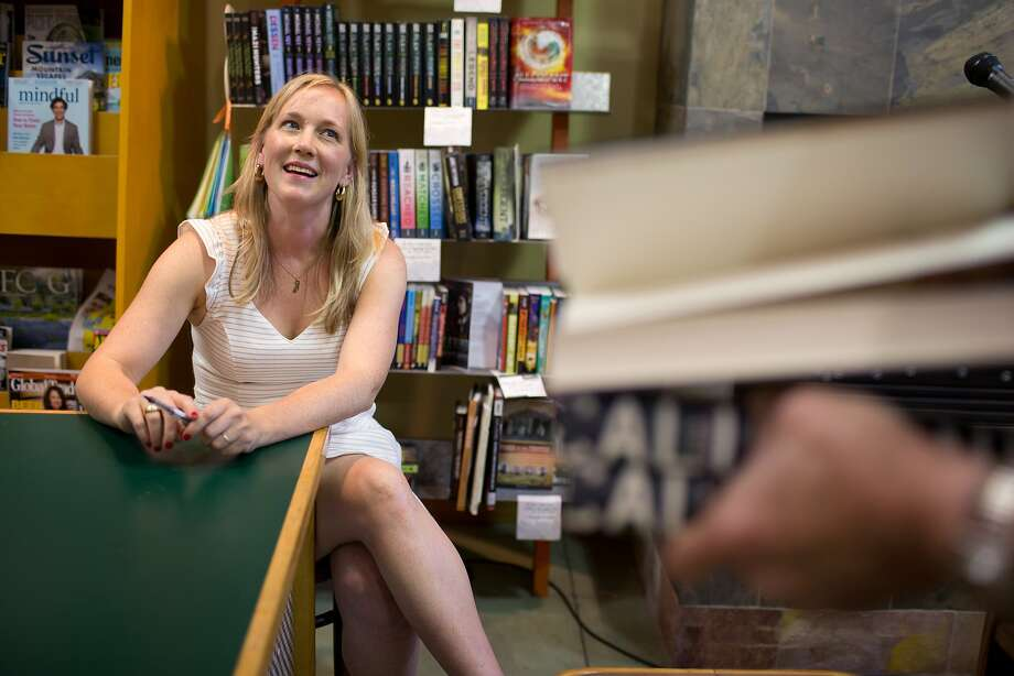 Author Edan Lepucki holds a book signing after reading from her new book, California, at Diesel, A Bookstore in Oakland, Calif. on Thursday, July 10, 2014. After a dispute between Amazon and Hachette Book Group, her publisher, Amazon removed the pre-order button for all Hachette books, including hers. Stephen Colbert, who is also a Hachette author, told his viewers to buy her book from Powell's Books, of Portland, Oregon. After this comment, sales of her book have skyrocketed. Photo: Tim Hussin, Special To The Chronicle