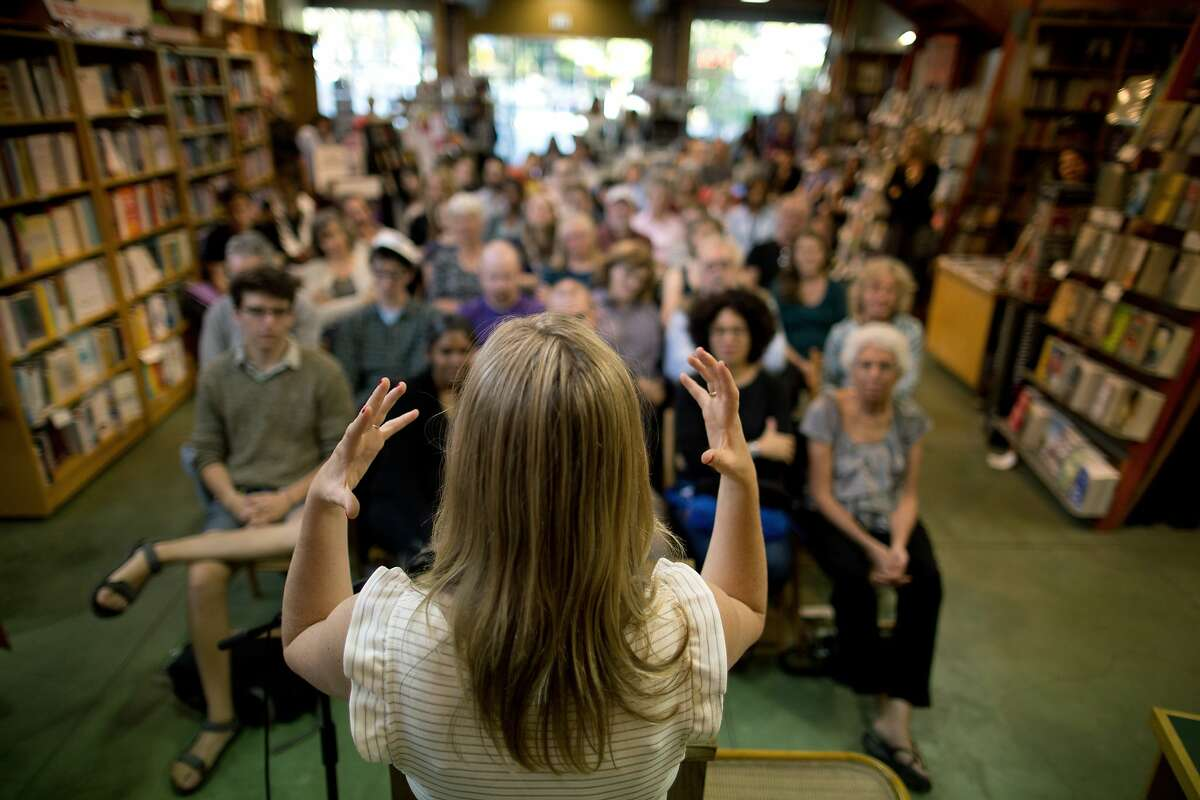 Author Edan Lepucki answers questions after reading from her new book, California, at Diesel, A Bookstore in Oakland, Calif. on Thursday, July 10, 2014. After a dispute between Amazon and Hachette Book Group, her publisher, Amazon removed the pre-order button for all Hachette books, including hers. Stephen Colbert, who is also a Hachette author, told his viewers to buy her book from Powell's Books, of Portland, Oregon. After this comment, sales of her book have skyrocketed.
