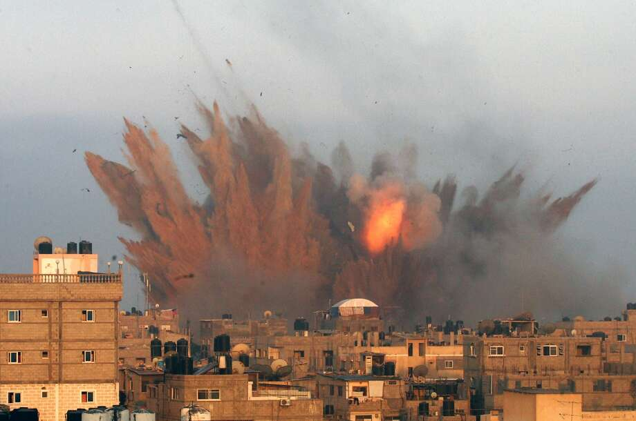 A massive fireball from an Israeli airstrike rises over Rafah, Gaza Strip. Israel responded to Palestinian rocket attacks with warplane raids that have so far left at least 100 Palestinians dead. Photo: Said Khatib, AFP/Getty Images