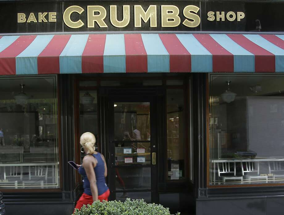 A Crumbs cupcake shop sits empty Tuesday on Federal Street in Boston. The chain shuttered its several dozen remaining locations this week. Photo: Stephan Savoia, Associated Press
