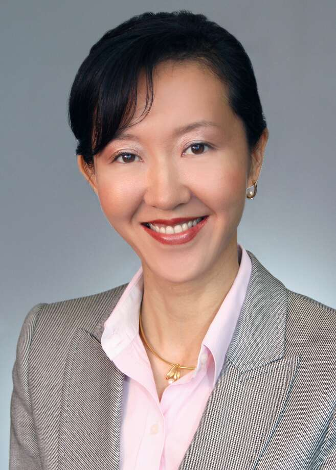 Bank of America has named Hong Ogle as market president for Houston. Ogle also serves as director of the downtown Houston complex for Merrill Lynch Wealth Management. / ONLINE_YES