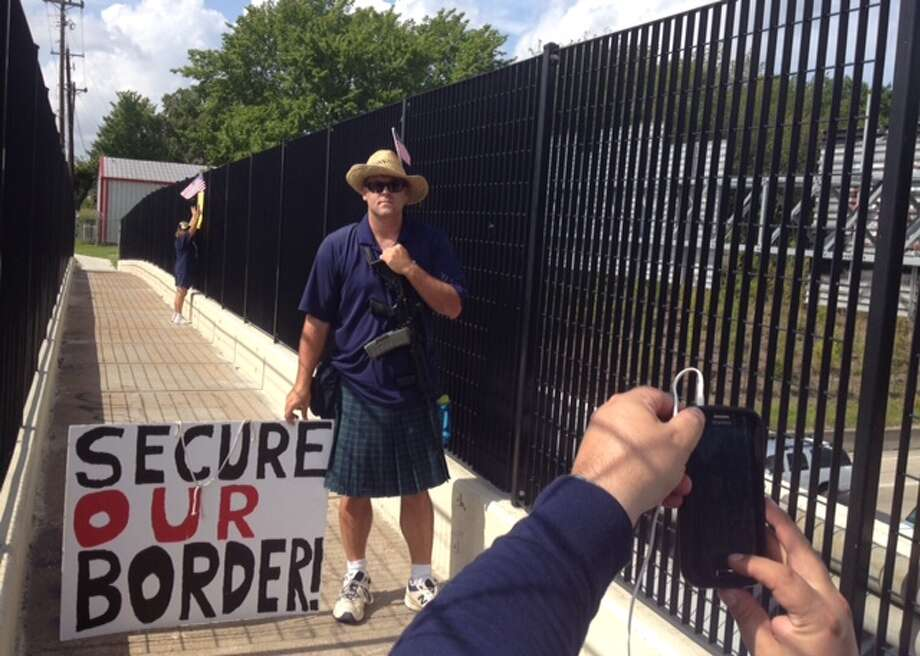 Armed protester at the I-10 pedestrian bridge at T.C. Jester, July 10, 2014.