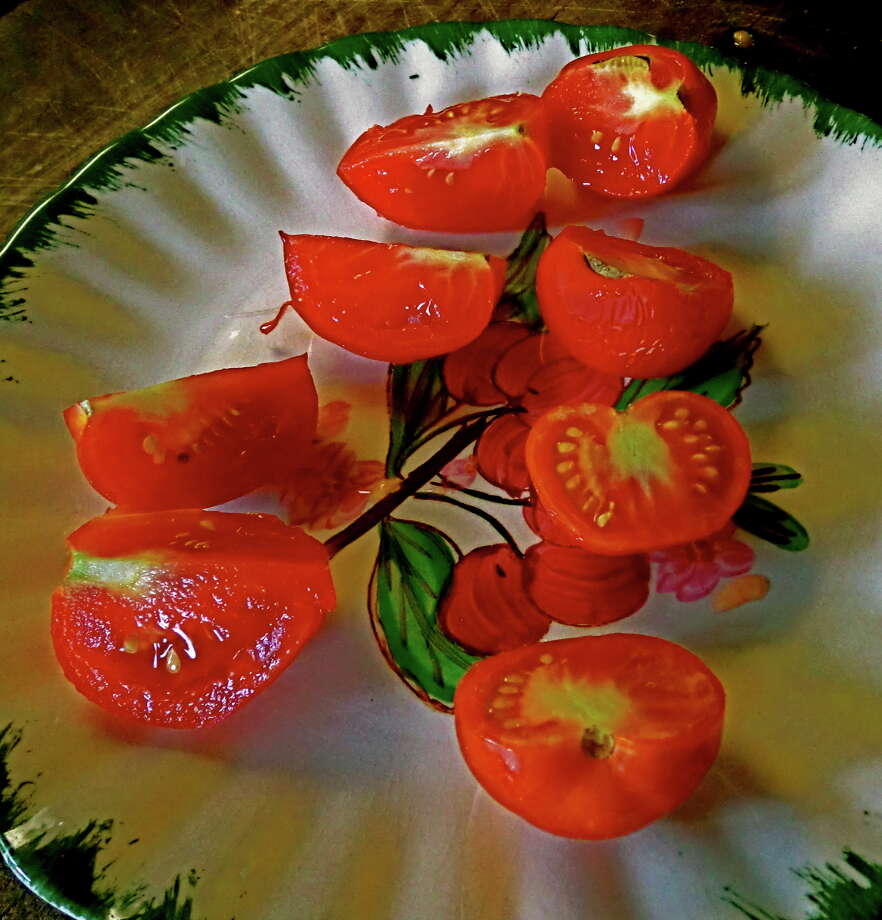 Open-pollinated Bloody Butcher tomatoes are early, reliable and delicious addition to the garden.