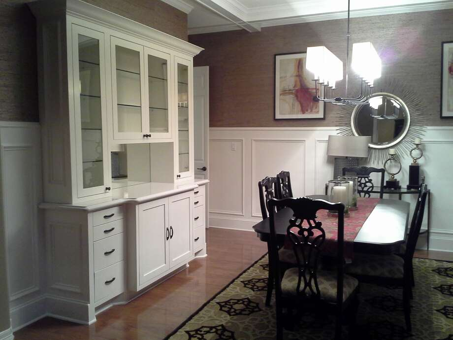 This dining room remodel features a new buffet, ceiling beams and paneling.