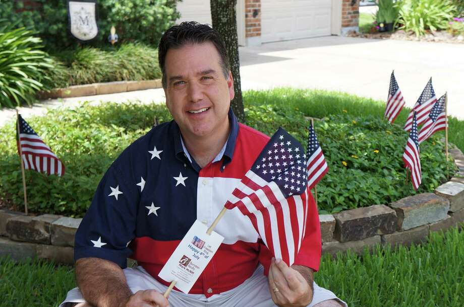 Bernstein Realty's Mark McNitt put out flags for every house in his Copper Village Neighborhood.