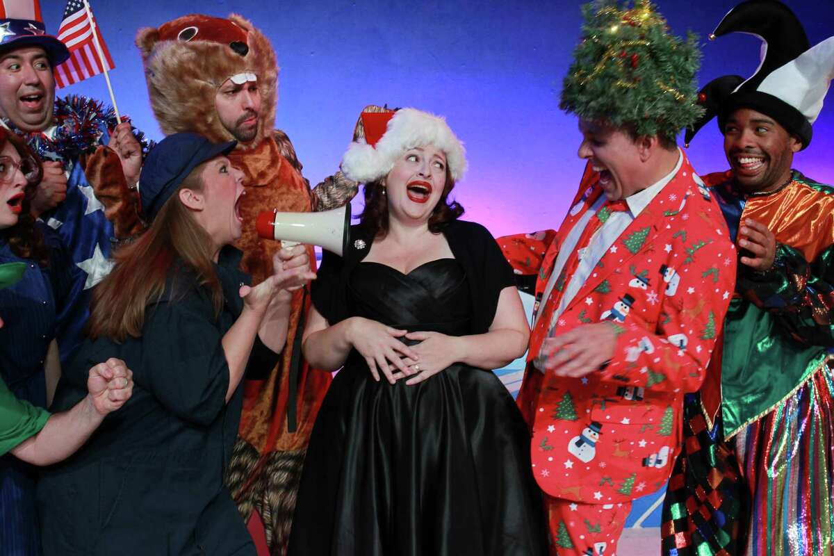 """Tamarie Cooper, center, with the cast, stars in Catastrophic Theatre's """"A Very Tamarie Christmas."""""""