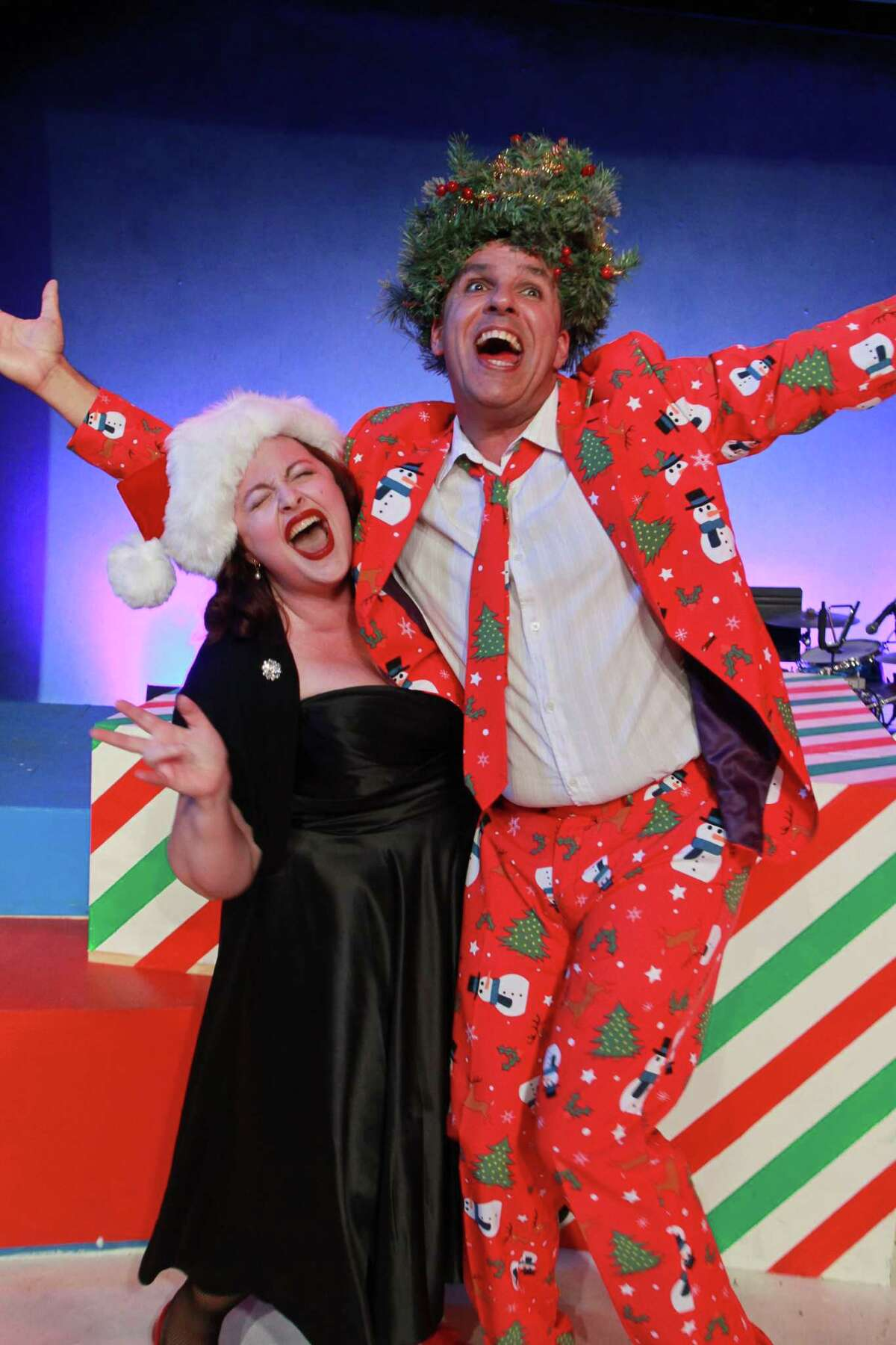 """(For the Chronicle/Gary Fountain, July 9, 2014) Tamarie Cooper with Greg Dean as Christmas, in this scene from Catastrophic Theatre's """"A very Tamarie Christmas,"""" a show spoofing Christmas and other holidays, well-known and virtually unknown."""