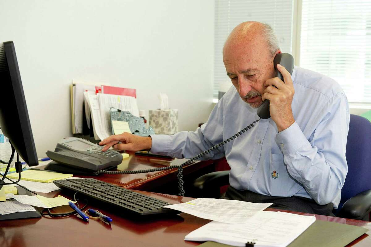 Martin Levine, special adviser to Stamford Mayor David Martin, makes phone calls in his Government Center office on Wednesday, July 9, 2014.