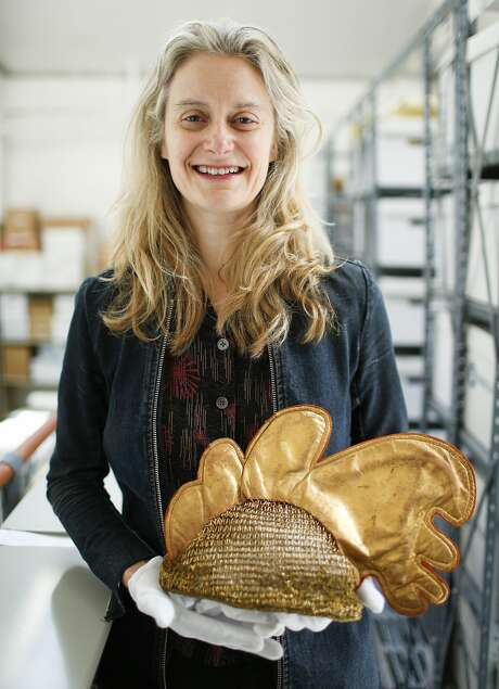 "Director Muriel Maffre holds a hat from a 1937 production of ""Le Coq d'Or."" Photo: Russell Yip, The Chronicle"