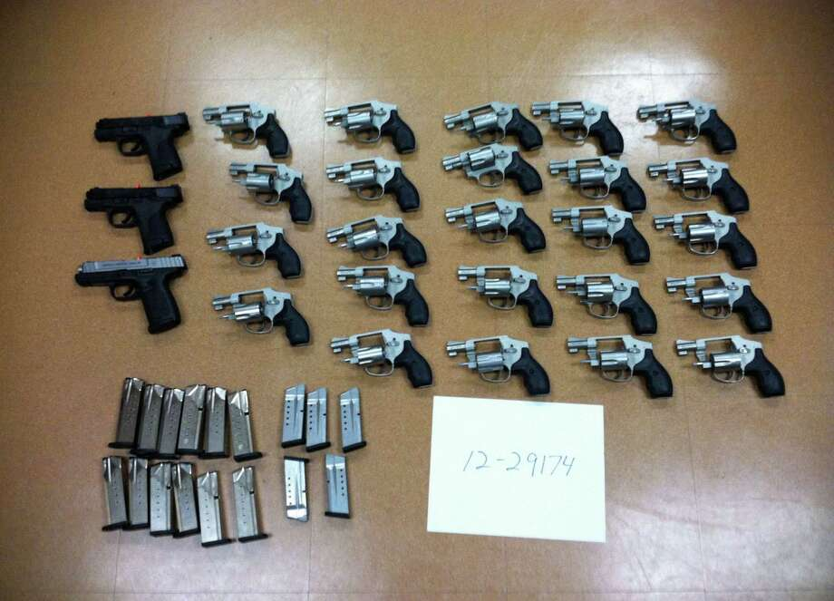 Stratford, Conn. police seized 29 guns stolen from a Smith & Wesson plant in Springfield, Mass. in Nov. 2012. Police said a local truck driver, Elliot Perez, stole the guns and drove them to Bridgeport, Conn. to sell them. Photo: Contributed Photo / Connecticut Post