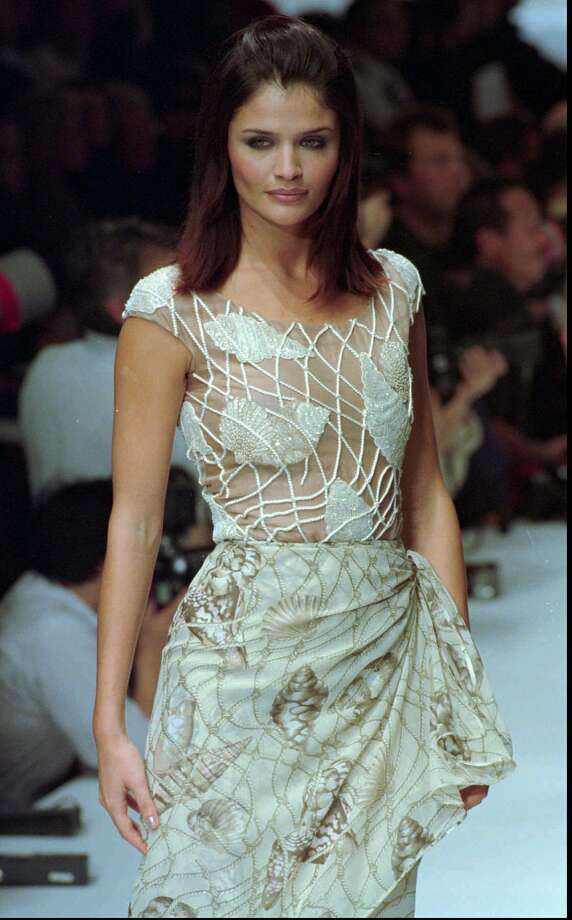 Danish model Helena Christensen models for Valentino in 1995, age 26. Photo: Lionel Cironneau, ASSOCIATED PRESS