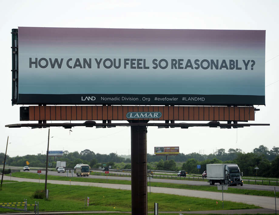 "A billboard just north of Ford Park on Interstate 10 reads ""HOW CAN YOU FEEL SO REASONABLY?"" on Tuesday afternoon. Artist Eve Fowler, as part of the Los Angeles Nomadic Division's Manifest Destiny Billboard Project, has placed three billboard messages between Beaumont and Winnie on Interstate 10. In addition, a ""lending library"" with books relating to the quotations has been installed at the M&D Supply on College Street. Photo taken Tuesday 7/8/14 Jake Daniels/@JakeD_in_SETX Photo: Jake Daniels / ©2014 The Beaumont Enterprise/Jake Daniels"