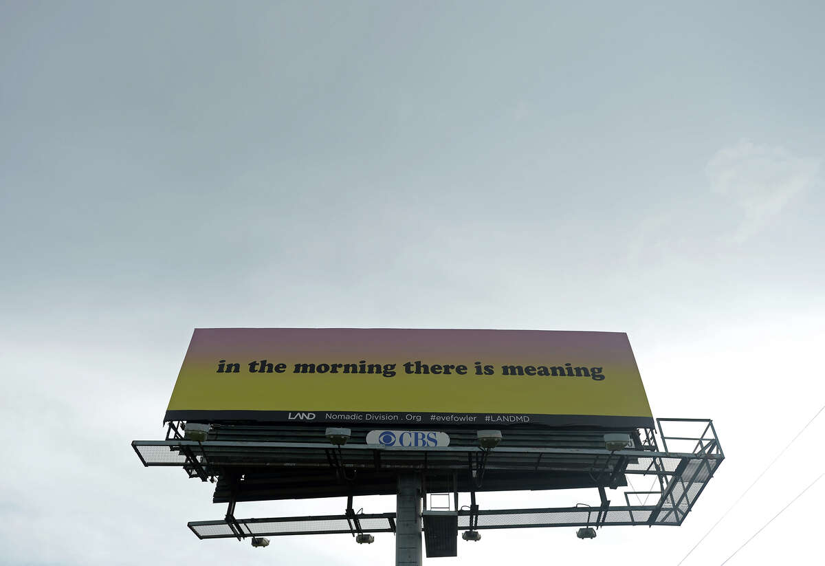 A billboard on the south side of Ford Park along Interstate 10 reads