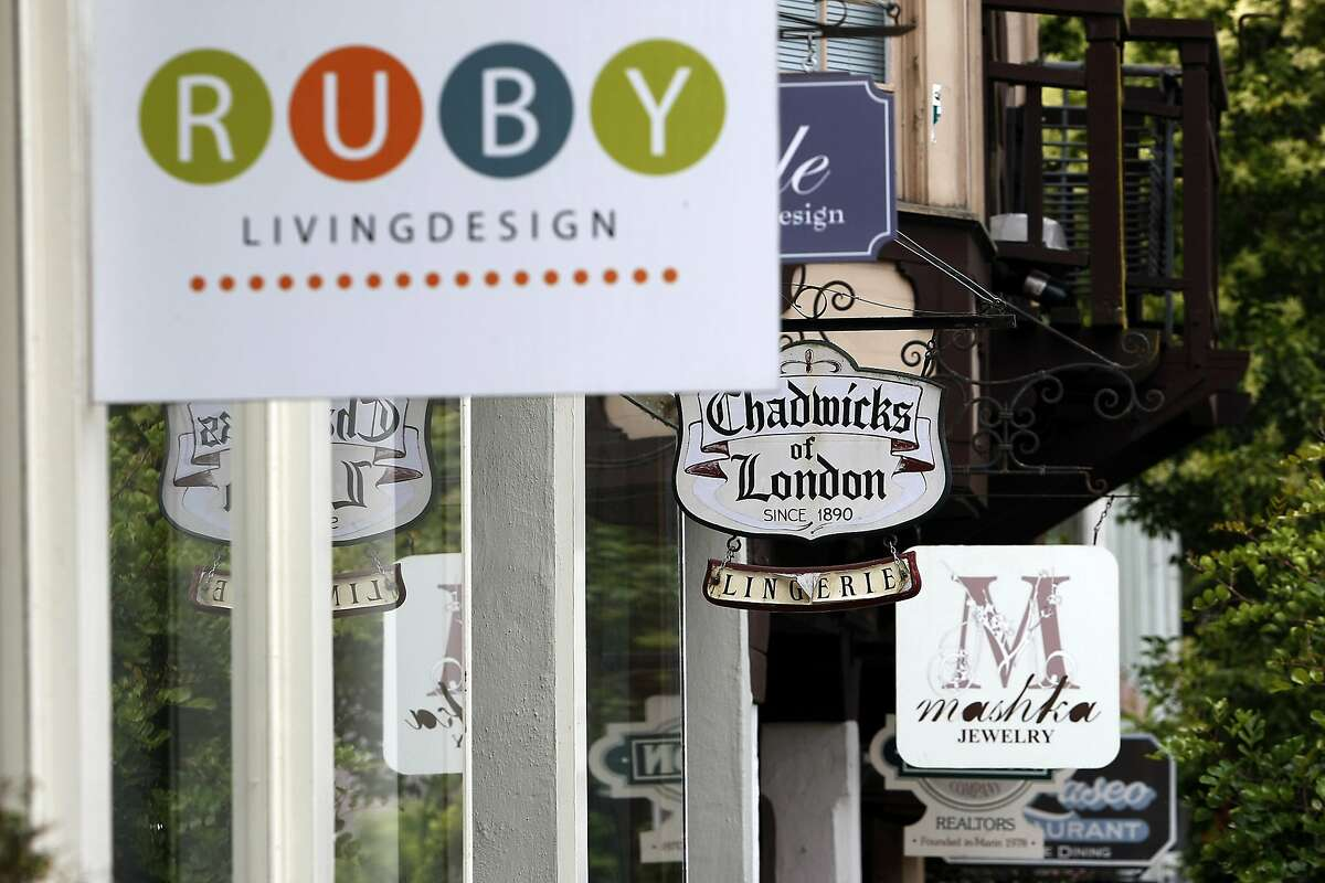 Signs for luxury shops are seen in Mill Valley, CA, Friday, July 11, 2014.